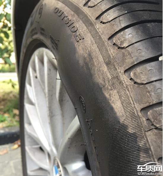 华晨宝马320i倍耐力轮胎鼓包高清图片